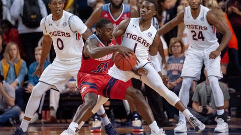 <p>               Auburn guard Jared Harper (1) defends against South Alabama guard John Pettway (50) during the first half of an NCAA college basketball game, Tuesday, Nov. 6, 2018, in Auburn, Ala. In background are Auburn forward Horace Spencer (0) and Auburn forward Anfernee McLemore (24). (AP Photo/Vasha Hunt)             </p>