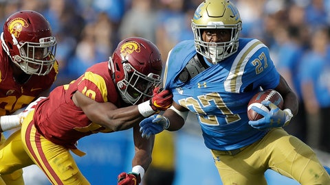 <p>               UCLA running back Joshua Kelley (27) rushes as Southern California linebacker John Houston Jr. (10) tugs on his jersey during the first half of an NCAA college football game Saturday, Nov. 17, 2018, in Pasadena, Calif. (AP Photo/Marcio Jose Sanchez)             </p>