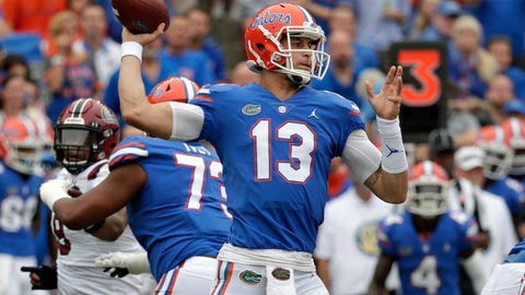 <p>               Florida quarterback Feleipe Franks (13) throws a pass as he is pressured by the South Carolina defense during the first half of an NCAA college football game, Saturday, Nov. 10, 2018, in Gainesville, Fla. (AP Photo/John Raoux)             </p>