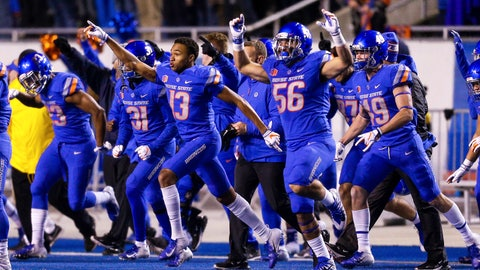 <p>               Boise State cornerback Marques Evans (13) and Boise State linebacker Joseph Inda (56) celebrate after the final play against Utah State in an NCAA college football game, Saturday, Nov. 24, 2018, in Boise, Idaho. Boise State won 33-24. (AP Photo/Steve Conner)             </p>