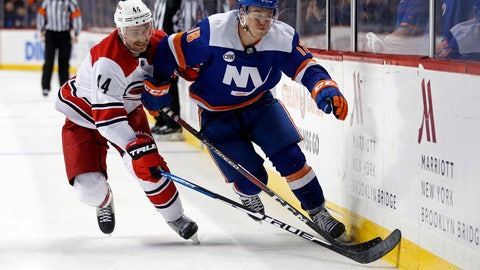 <p>               New York Islanders left wing Anthony Beauvillier (18) battles for the puck with Carolina Hurricanes defenseman Calvin de Haan (44) in the second period of an NHL hockey game Saturday, Nov. 24, 2018, in New York. (AP Photo/Adam Hunger)             </p>