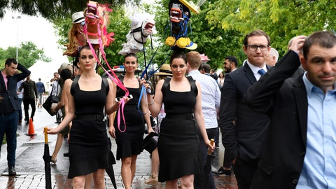 <p>               Racegoers arrive before the running of the Melbourne Cup at the Flemington Racecourse in Melbourne, Australia, Tuesday, Nov. 6, 2018. (AP Photo/Andy Brownbill)             </p>