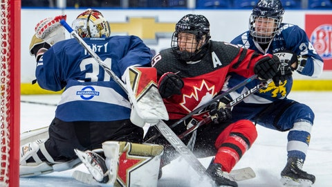 <p>               Canada forward Brianne Jenner and Finland forward Noora Tulus collide with Finland goaltender Noora Raty during the third period of a Four Nations Cup hockey preliminary game in Saskatoon, Saskatchewan, Friday, Nov. 9, 2018. (Liam Richards/The Canadian Press via AP)             </p>