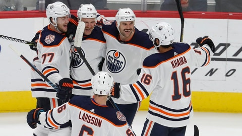 <p>               Edmonton Oilers center Kyle Brodziak (28) celebrates after a goal with teammates defenseman Oscar Klefbom (77), right wing Zack Kassian (44), left wing Jujhar Khaira (16) and defenseman Adam Larsson (6) during the third period of an NHL hockey game against the Detroit Red Wings, Saturday, Nov. 3, 2018, in Detroit. Edmonton won, 4-3. (AP Photo/Carlos Osorio)             </p>