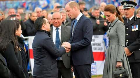 <p>               Leicester City Vice chairman Aiyawatt Srivaddhanaprabha, the son of deceased owner Vichai Srivaddhanaprabha, left, shakes hands and talks with Britain's Prince William and Kate, Duchess The Duke of Cambridge, as they view tributes to those who were killed in an helicopter crash at Leicester City Football Club's King Power Stadium in Leicester, England, Wednesday, Nov. 28, 2018. Vichai Srivaddhanaprabha, the Thai billionaire owner of Premier League team Leicester City was among five people who died after his helicopter crashed and burst into flames shortly after taking off from the soccer field on Saturday Oct. 27, 2018. (AP Photo/Arthur Edwards)             </p>