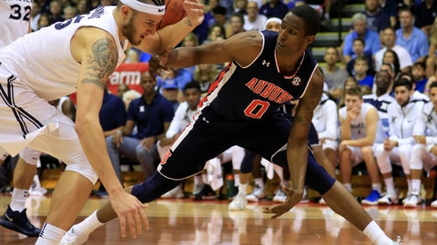 <p>               Xavier forward Zach Hankins (35) fights for a loose ball against Auburn forward Horace Spencer (0) during the first half of an NCAA college basketball game at the Maui Invitational, Monday, Nov. 19, 2018, in Lahaina, Hawaii. (AP Photo/Marco Garcia)             </p>