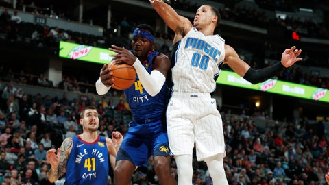 <p>               Denver Nuggets forward Paul Millsap, center left, pulls in a rebound as Orlando Magic forward Aaron Gordon (00) defends in the first half of an NBA basketball game Friday, Nov. 23, 2018, in Denver. (AP Photo/David Zalubowski)             </p>