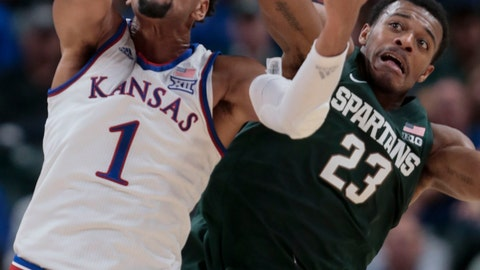 <p>               Kansas forward Dedric Lawson (1) fights for a rebound with Michigan State forward Xavier Tillman (23) during the first half of an NCAA college basketball game at the Champions Classic in Indianapolis on Tuesday, Nov. 6, 2018. (AP Photo/AJ Mast)             </p>