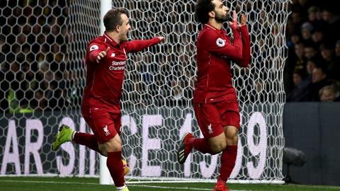 <p>               Liverpool's Mohamed Salah, right, celebrates scoring his side's first goal of the game with team mate Xherdan Shaqiri during their English Premier League soccer match against Watford at Vicarage Road, Watford, England, Saturday, Nov. 24, 2018. (Chris Radburn/PA via AP)             </p>