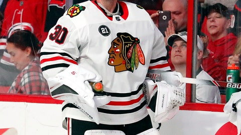 <p>               Chicago Blackhawks goaltender Cam Ward (30) watches the scoreboard as the Hurricanes' play a tribute video to their former long time goaltender during the first period of an NHL hockey game against the Carolina Hurricanes, Monday, Nov. 12, 2018, in Raleigh, N.C. (AP Photo/Karl B DeBlaker)             </p>