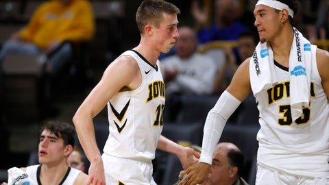 <p>               Iowa guard Joe Wieskamp is greeted by teammate Cordell Pemsl, right, at the end of an NCAA college basketball game against UKMC, Thursday, Nov. 8, 2018, in Iowa City, Iowa. (AP Photo/Charlie Neibergall)             </p>