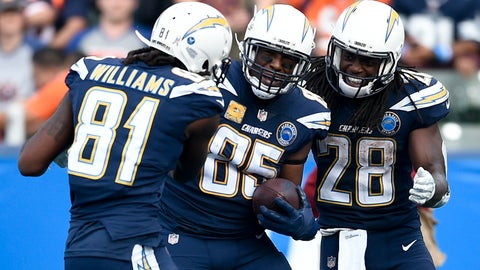 <p>               Los Angeles Chargers tight end Antonio Gates, middle, celebrates after scoring with Mike Williams and Melvin Gordon right, during the second half of an NFL football game against the Denver Broncos Sunday, Nov. 18, 2018, in Carson, Calif. (AP Photo/Kelvin Kuo)             </p>