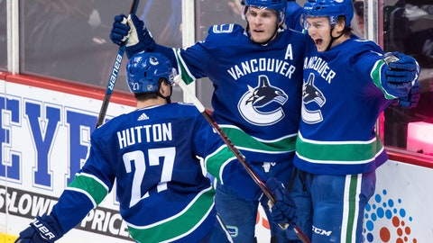 <p>               Vancouver Canucks' Jake Virtanen, right, celebrates his second goal against the Chicago Blackhawks with teammates Bo Horvat, back left, and Ben Hutton during the second period of an NHL hockey game Wednesday, Oct. 31, 2018, in Vancouver, British Columbia. (Darryl Dyck/The Canadian Press via AP)             </p>
