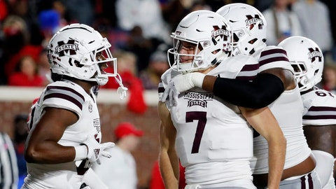 <p>               Mississippi State quarterback Nick Fitzgerald (7) is congratulated by teammates following an 8-yard touchdown run against Mississippi during the first half of an NCAA college football game in Oxford, Miss., Thursday, Nov. 22, 2018. (AP Photo/Rogelio V. Solis)             </p>