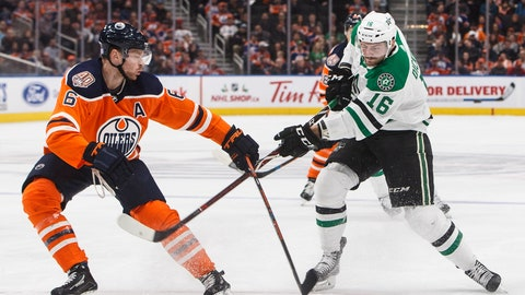 <p>               Dallas Stars' Jason Dickinson (16) is poke checked by Edmonton Oilers' Adam Larsson (6) during first period NHL hockey action in Edmonton, Alberta, on Tuesday Nov. 27, 2018. (Jason Franson/The Canadian Press via AP)             </p>