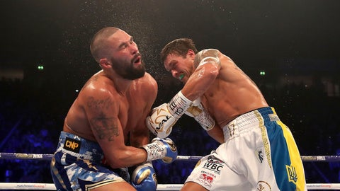 <p>               Tony Bellew, left, reacts to a blow from Oleksandr Usyk during their cruiserweight boxing bout Saturday, Nov. 10, 2018, in Manchester, England. Usyk successfully defended his four belts and likely sent Bellew into retirement by knocking out the British fighter in the eighth round. (Nick Potts/PA via AP)             </p>