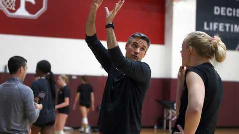 <p>               In this Wednesday, Nov. 28, 2018, photo, Stanford volleyball coach Kevin Hambly gestures while speaking with player Kathryn Plummer during a workout in Stanford, Calif. Stanford is riding a 26-game winning streak and just completed a 20-0 run through Pac-12 play to become the conference's first undefeated team since Southern California in 2003. (AP Photo/Ben Margot)             </p>