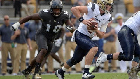 <p>               FILE - In this Nov. 10, 2018, file photo, Navy quarterback Zach Abey (9) rushes for yardage in front of Central Florida defensive lineman Titus Davis (10) during the first half of an NCAA college football game in Orlando, Fla. Navy faces Tulsa on Saturday. (AP Photo/Phelan M. Ebenhack, File)             </p>