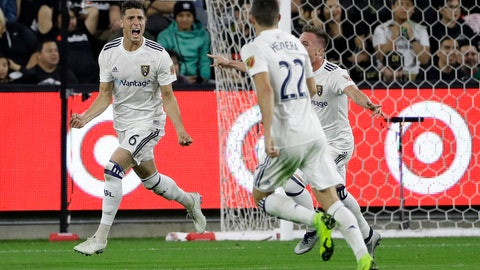<p>               Real Salt Lake's Damir Kreilach, left, celebrates after scoring against Los Angeles FC during the first half of an MLS soccer playoff match Thursday, Nov. 1, 2018, in Los Angeles. (AP Photo/Marcio Jose Sanchez)             </p>
