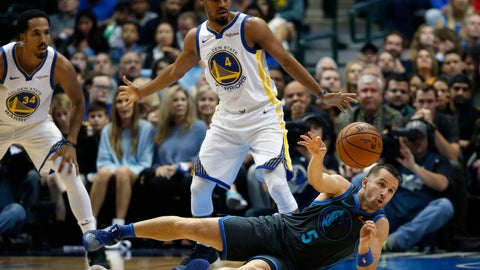 <p>               Dallas Mavericks guard J.J. Barea (5) passes from the floor as Golden State Warriors guards Quinn Cook (4) and Shaun Livingston (34) look on during the first half of an NBA basketball game, Saturday, Nov. 17, 2018, in Dallas. (AP Photo/Ron Jenkins)             </p>