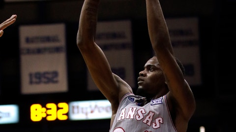 <p>               Kansas guard Lagerald Vick (24) shoots a three-point basket during the first half of an NCAA college basketball game against Vermont in Lawrence, Kan., Monday, Nov. 12, 2018. (AP Photo/Orlin Wagner)             </p>
