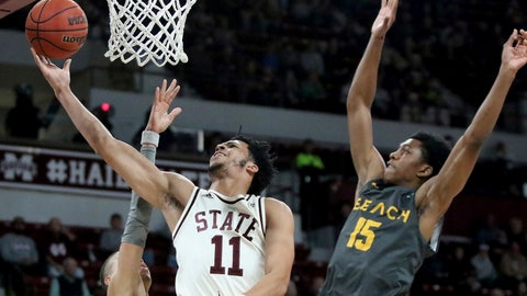 <p>               Mississippi State guard Quinndary Weatherspoon (11) drives to the basket between Long Beach State guards Ron Freeman and Deishuan Booker (15) during the first half of an NCAA college basketball game Friday, Nov. 16, 2018, in Starkville, Miss. (AP Photo/Jim Lytle)             </p>