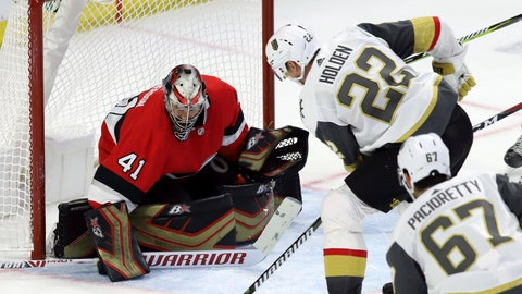 <p>               Vegas Golden Knights defenseman Nick Holden (22) scores on Ottawa Senators goaltender Craig Anderson (41) as Vegas Golden Knights left wing Max Pacioretty (67) looks on during the second period of an NHL hockey game, Wednesday, Nov. 8, 2018 in Ottawa, Ontario. (Fred Chartrand/The Canadian Press via AP)             </p>