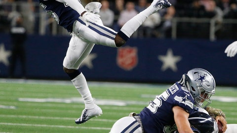<p>               Dallas Cowboys linebacker Leighton Vander Esch (55) hits Tennessee Titans quarterback Marcus Mariota (8) during the second half of an NFL football game, Monday, Nov. 5, 2018, in Arlington, Texas. Vander Esch drew a foul on the play. (AP Photo/Michael Ainsworth)             </p>