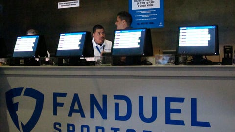 <p>               This July 14, 2018 file photo shows workers at the FanDuel sports book at the Meadowlands Racetrack in East Rutherford, N.J., preparing to take bets moments before it opened. FanDuel on Nov. 30 paid off on bets customers made on Alabama to win the national college football championship a month before the game is played. (AP Photo/Wayne Parry, File)             </p>
