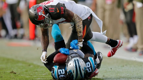 <p>               Carolina Panthers' Donte Jackson (26) intercepts a pass intended for Tampa Bay Buccaneers' DeSean Jackson (11) in the second half of an NFL football game in Charlotte, N.C., Sunday, Nov. 4, 2018. (AP Photo/Nell Redmond)             </p>
