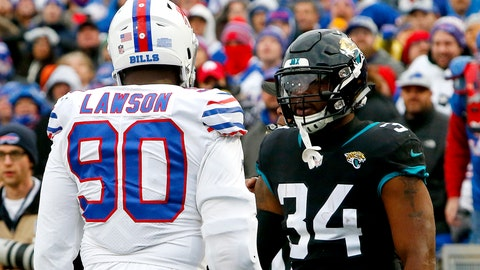 <p>               Buffalo Bills defensive end Shaq Lawson (90) argues with Jacksonville Jaguars running back Carlos Hyde (34) during the second half of an NFL football game, Sunday, Nov. 25, 2018, in Orchard Park, N.Y. Lawson was ejected after the argument led to a fight with Jaguars running back Leonard Fournette. (AP Photo/Jeffrey T. Barnes)             </p>