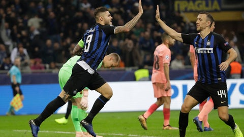 <p>               Inter forward Mauro Icardi, left, celebrates after scoring his side's opening goal with his teammate Inter midfielder Ivan Perisic during the Champions League group B soccer match between Inter Milan and Barcelona at the San Siro stadium in Milan, Italy, Tuesday, Nov. 6, 2018. (AP Photo/Luca Bruno)             </p>