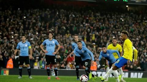 <p>               Brazil's Neymar scores a penalty during the international friendly soccer match between Brazil and Uruguay at the Emirates Stadium, London, Friday, Nov. 16, 2018. (AP Photo/Matt Dunham)             </p>