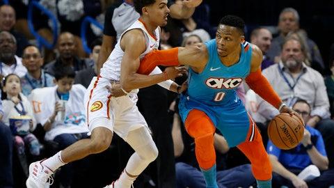 <p>               Oklahoma City Thunder guard Russell Westbrook (0) drives around Atlanta Hawks guard Trae Young (11) during the first half of an NBA basketball game in Oklahoma City, Friday, Nov. 30, 2018. (AP Photo/Alonzo Adams)             </p>