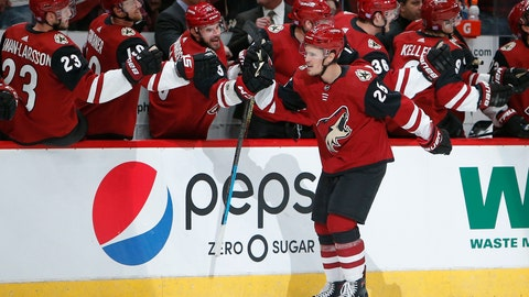 <p>               Arizona Coyotes center Nick Cousins (25) celebrates with teammates after scoring a goal against the Carolina Hurricanes during the first period of an NHL hockey game Friday, Nov. 2, 2018, in Glendale, Ariz. (AP Photo/Rick Scuteri)             </p>