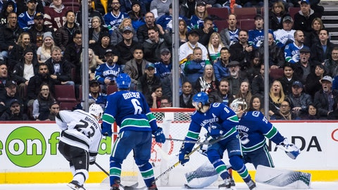 <p>               Los Angeles Kings' Dustin Brown (23) scores against Vancouver Canucks goalie Jacob Markstrom, right, of Sweden, as Brock Boeser (6) and Chris Tanev (8) defend during overtime of an NHL hockey game Tuesday, Nov. 27, 2018, in Vancouver, British Columbia. (Darryl Dyck/The Canadian Press via AP)             </p>