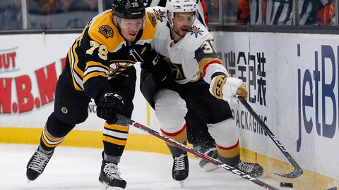 <p>               Boston Bruins' Jeremy Lauzon (79) and Vegas Golden Knights' Tomas Hyka (38) battle for the puck and during the first period of an NHL hockey game in Boston, Sunday, Nov. 11, 2018. (AP Photo/Michael Dwyer)             </p>