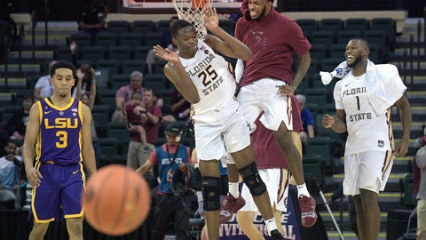 <p>               Florida State forward Mfiondu Kabengele (25) is congratulated by guard PJ Savoy, second from right, and forward Raiquan Gray (1), as LSU guard Tremont Waters (3) walks away, after getting the 79-76 win in overtime of an NCAA college basketball game Friday, Nov. 23, 2018, in Lake Buena Vista, Fla. Kabengele hit a game-winning three-pointer. (AP Photo/Phelan M. Ebenhack)             </p>