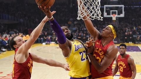 <p>               Los Angeles Lakers forward LeBron James, center, shoots as Indiana Pacers forward Bojan Bogdanovic, left, of Croatia, and center Myles Turner defend during the first half of an NBA basketball game Thursday, Nov. 29, 2018, in Los Angeles. (AP Photo/Mark J. Terrill)             </p>