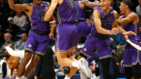 <p>               Furman guard Alex Hunter (10) and forward Clay Mounce (45) celebrate after their team defeated Villanova 76-68 in overtime in an NCAA college basketball game, Saturday, Nov. 17, 2018, in Villanova, Pa. (AP Photo/Laurence Kesterson)             </p>