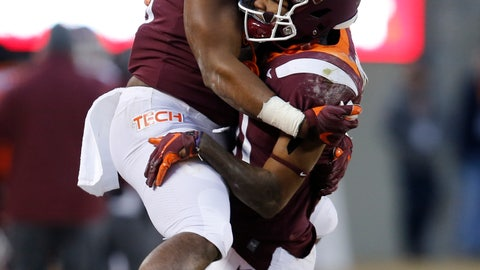 <p>               Virginia Tech wide receiver Tre Turner, right, celebrates a touchdown with teammate Eli Adams, left, during the first half of an NCAA college football game in Blacksburg, Va., Friday, Nov. 23, 2018. (AP Photo/Steve Helber)             </p>