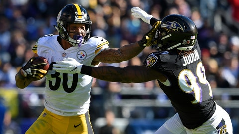 <p>               Pittsburgh Steelers running back James Conner, left, rushes past Baltimore Ravens outside linebacker Matt Judon in the first half of an NFL football game, Sunday, Nov. 4, 2018, in Baltimore. (AP Photo/Gail Burton)             </p>