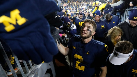 <p>               Michigan quarterback Shea Patterson (2) celebrates on the way to the locker room after beating Indiana 31-20 in an NCAA college football game in Ann Arbor, Mich., Saturday, Nov. 17, 2018. (AP Photo/Paul Sancya)             </p>