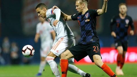 <p>               Croatia's Domagoj Vida, right, challenges for the ball with Spain's Paco Alcacer during the UEFA Nations League soccer match between Croatia and Spain at the Maksimir stadium in Zagreb, Croatia, Thursday, Nov. 15, 2018. (AP Photo/Darko Bandic)             </p>