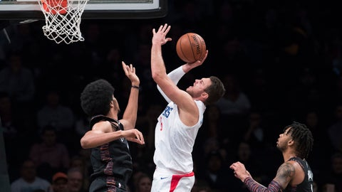 <p>               Los Angeles Clippers forward Danilo Gallinari, center, goes to the basket against Brooklyn Nets guard D'Angelo Russell (1) and center Jarrett Allen, left, during the second half of an NBA basketball game, Saturday, Nov. 17, 2018, in New York. The Clippers won 127-119. (AP Photo/Mary Altaffer)             </p>