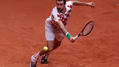 <p>               Croatia's Marin Cilic returns the ball to France's Lucas Pouille during the Davis Cup final between France and Croatia Sunday, Nov. 25, 2018 in Lille, northern France. (AP Photo/Thibault Camus)             </p>