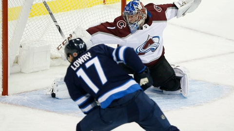 <p>               Winnipeg Jets' Adam Lowry's (17) shot is saved by Colorado Avalanche goaltender Semyon Varlamov (1) during the first period of an NHL hockey game, Friday, Nov. 9, 2018, in Winnipeg, Manitoba. (John Woods/The Canadian Press via AP)             </p>