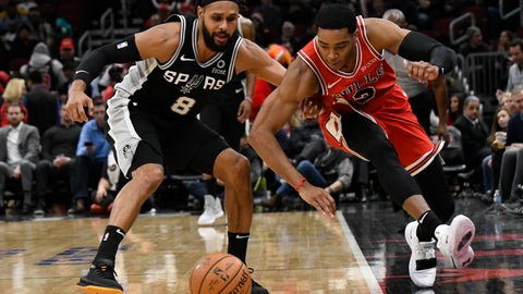 <p>               San Antonio Spurs guard Patty Mills (8) and Chicago Bulls guard Shaquille Harrison (3) go for the ball during the first half of an NBA basketball game Monday, Nov. 26, 2018, in Chicago. (AP Photo/David Banks)             </p>