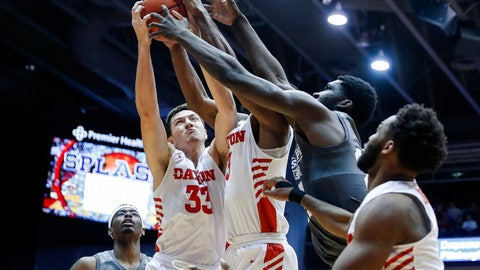 <p>               Dayton's Ryan Mikesell (33) competes for a rebound against a teammate and Mississippi State's Abdul Ado, second from right, during the first half of an NCAA college basketball game Friday, Nov. 30, 2018, in Cincinnati. (AP Photo/John Minchillo)             </p>