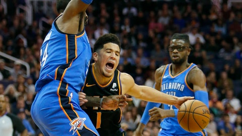 <p>               Phoenix Suns guard Devin Booker (1) drives on Oklahoma City Thunder forward Patrick Patterson during the first half of an NBA basketball game Saturday, Nov. 17, 2018, in Phoenix. (AP Photo/Rick Scuteri)             </p>